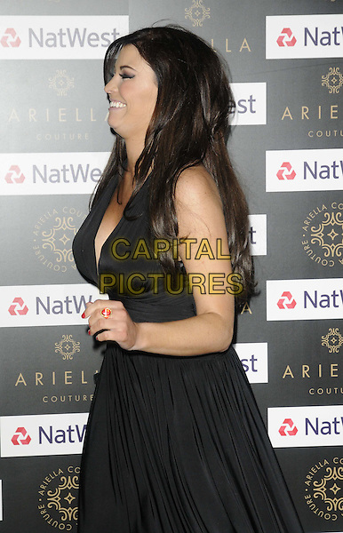 Jessica Wright.The Ariella Couture catwalk show & reception, Natwest & RBS International HQ, Bishopsgate, London, England..April 17th, 2012.half length black dress low cut neckline cleavage side profile smiling funny.CAP/CAN.©Can Nguyen/Capital Pictures.