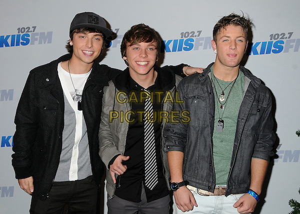 Emblem3 - Drew Chadwick, Keaton Stromberg & Wesley Stromberg .Emblem 3.attends the 102.7 KIIS FM'S Jingle Ball 2012 held at The Nokia Theater Live in Los Angeles, California, USA,.December 1st 2012..half length brothers family siblings x factor usa hand gesture cap hat grey gray jacket black hoodie green .CAP/ADM/BP.©Byron Purvis/AdMedia/Capital Pictures.
