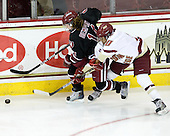Jillian Dempsey (Harvard - 14), Blake Bolden (BC - 10) - The Boston College Eagles defeated the Harvard University Crimson 3-1 to win the 2011 Beanpot championship on Tuesday, February 15, 2011, at Conte Forum in Chestnut Hill, Massachusetts.