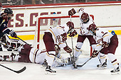 Kasperi Ojantakanen (UConn - 23), Joe Woll (BC - 31), Michael Kim (BC - 4), David Cotton (BC - 17), Austin Cangelosi (BC - 9) - The Boston College Eagles defeated the visiting UConn Huskies 2-1 on Tuesday, January 24, 2017, at Kelley Rink in Conte Forum in Chestnut Hill, Massachusetts.