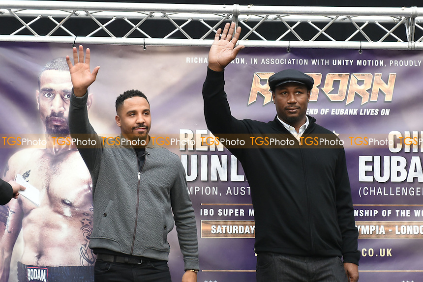 Andre Ward (L) and Lennox Lewis wave to the fans during a Poxon Sports Weigh-In at Westfield Shopping Centre on 3rd February 2017