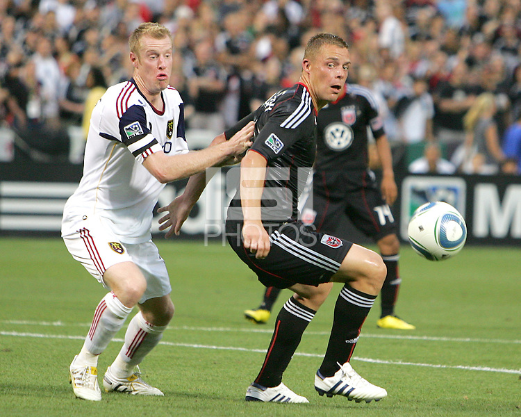 Danny Allsopp #9 of D.C. United with Nat Borchers #6 of Real Salt Lake during an MLS match at RFK Stadium, on June 5 2010 in Washington DC. The game ended in a 0-0 tie.
