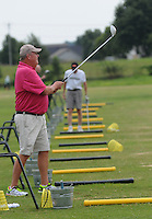 NWA Democrat-Gazette/FLIP PUTTHOFF<br /> EYE ON THE BALL<br /> Steve Ross of Rogers watches a shot while hitting golf balls Friday August 28 2015 at The First Tee golf center in Lowell. Ross and others were sharpening their game at the center's J.B. Hunt Driving Range