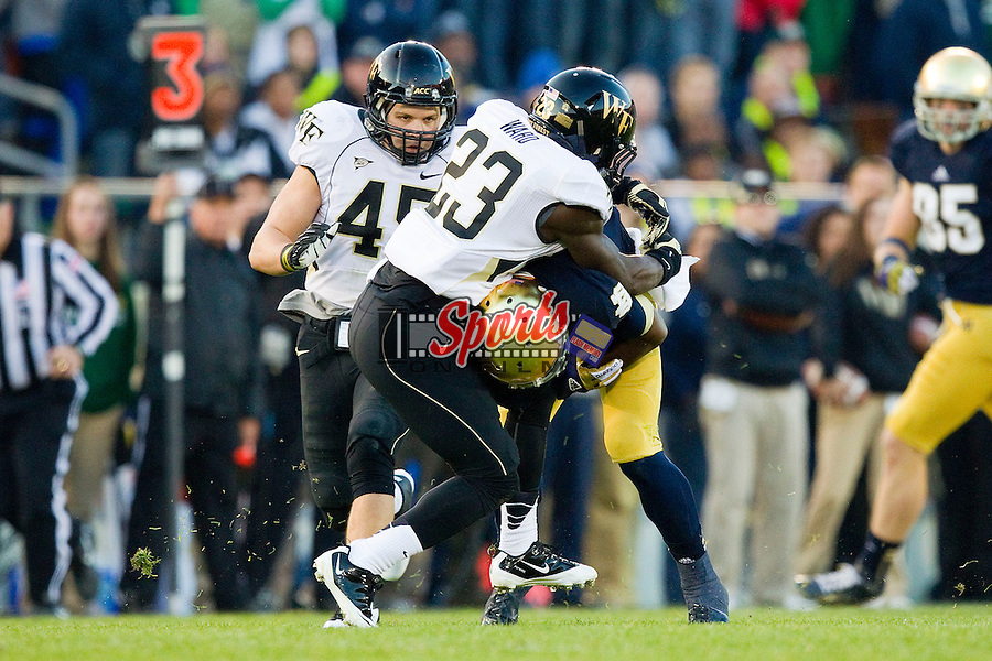 James Ward (23) of the Wake Forest Demon Deacons tackles Theo Riddick (6) of the Notre Dame Fighting Irish during second quarter action at Notre Dame Stadium on November 17, 2012 in South Bend, Indiana.  The Fighting Irish defeated the Demon Deacons 38-0.  (Brian Westerholt/Sports On Film)