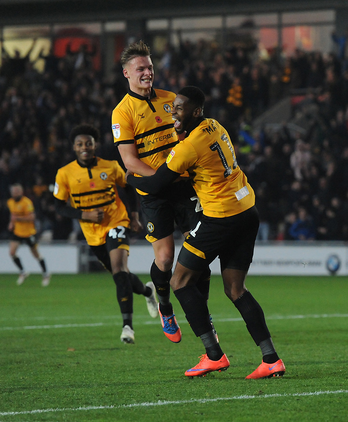 Newport County's Cameron Pring celebrates scoring his side's second goal with team-mate Jamille Matt<br /> <br /> Photographer Kevin Barnes/CameraSport<br /> <br /> The EFL Sky Bet League Two - Newport County v Colchester United - Saturday 17th November 2018 - Rodney Parade - Newport<br /> <br /> World Copyright © 2018 CameraSport. All rights reserved. 43 Linden Ave. Countesthorpe. Leicester. England. LE8 5PG - Tel: +44 (0) 116 277 4147 - admin@camerasport.com - www.camerasport.com