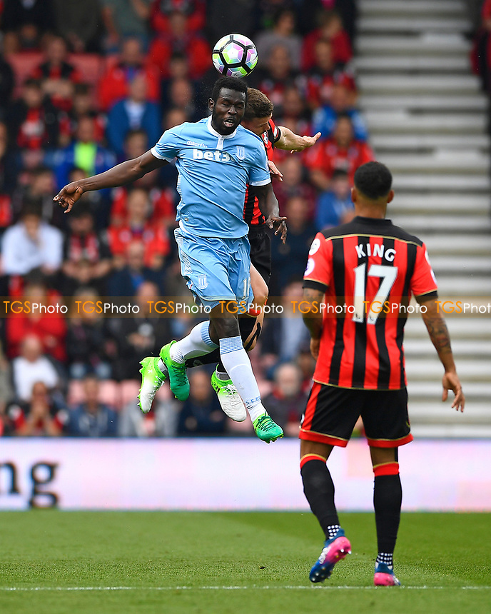 Mame Biram Diouf of Stoke City wins a header from Simon Francis of AFC Bournemouth during AFC Bournemouth vs Stoke City, Premier League Football at the Vitality Stadium on 6th May 2017