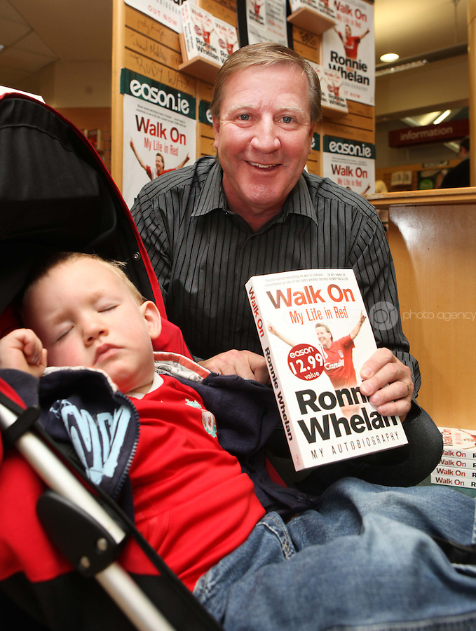 ***NO FEE PIC ***.10/09/2011.Eason Ireland's leading retailer of books , stationery, magazines & lots more hosted a book signing by former Liverpool & Irish international soccer player Ronnie Whelan..Pictured at Eason O' Connell street, Dublin is Ronnie Whelan &  Eoghan Brogan (2) from Tallaght signing copies of his new autobiography WALK ON for fans..Follow Eason on twitter- @easons..Photo: Collins