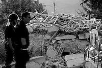 Illica, Rieti, 26 Agosto 2016.<br /> Vigili del fuoco e volontari tra le macerie degli edifici crollati ad Illica, frazione di Accumoli. <br /> L'Italia &egrave; stata colpita da un potente, terremoto di 6,2 magnitudo nella notte del 24 agosto, 2016, che ha ucciso almeno 290 persone .<br /> Firefighters and volunteers in the rubble of collapsed buildings  in Illica, a hamlet of Accumoli, earthquake epicenter in central Italy was struck by a powerful, 6.2-magnitude earthquake in the night of August 24, 2016, Which has killed at least 290 people and devastated hundreds of houses.