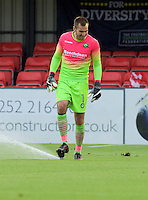 Goalkeeper Scott Brown of Wycombe Wanderers tries to push the sprinkler down after it comes on in the first half of the game during the Friendly match between Aldershot Town and Wycombe Wanderers at the EBB Stadium, Aldershot, England on 26 July 2016. Photo by Alan  Stanford.