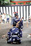 Officials in traditional ceremonial garb perform a well-rehearsed exchange of arrows during the Yabusame Shinji ritual in Kamakura, near Tokyo. The ritual involves several riders on horseback firing arrows at targets while galloping at speed and dates back to the 12th century. It is  aimed at appeasing the numerous gods that guard Japan and was initiated by Kamakura shogun Minamoto no Yoritomo  in an attempt to improve his samurai warrior's appalling archery skills.