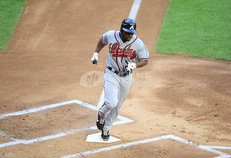 Apr. 21, 2012; Phoenix, AZ, USA; Atlanta Braves base runner Michael Bourn touches home to score in the first inning against the Arizona Diamondbacks at Chase Field.  Mandatory Credit: Mark J. Rebilas-