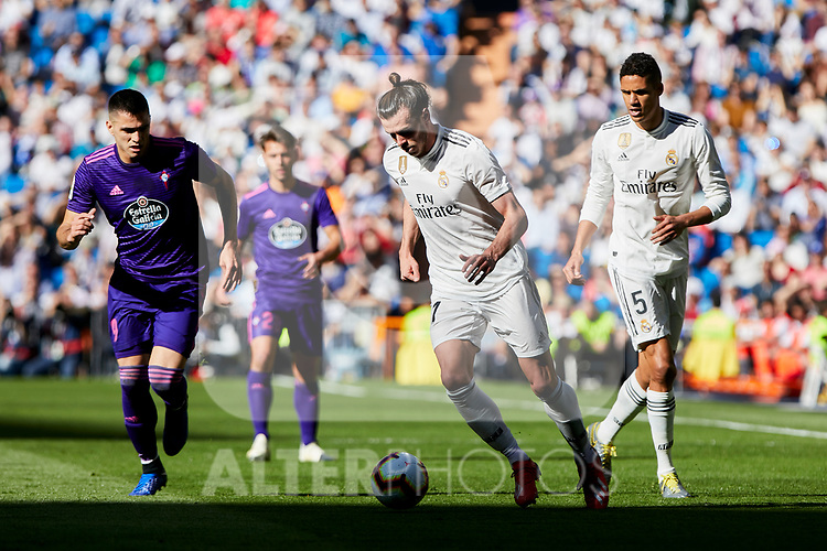 Real Madrid's Gareth Bale (L) and Raphael Varane (R) and Real Club Celta de Vigo's Maxi Gomez during La Liga match between Real Madrid and Real Club Celta de Vigo at Santiago Bernabeu Stadium in Madrid, Spain. March 16, 2019. (ALTERPHOTOS/A. Perez Meca)