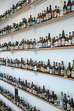 USA, Oregon, Ashland, wall detail of the beer bottle collection at the Caldera Brewery and Restaurant