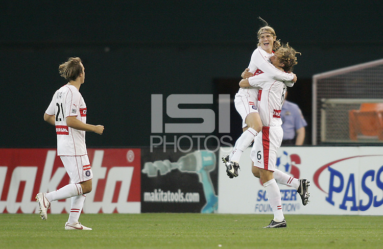 9 April 2005.   The Chicago Fire's Kelly Gray (6) and Chris Rolfe (17) celebrate a goal at RFK Stadium in Washington, DC.