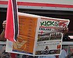 15 June 2006: A Trinidad fan reads a newspaper on the train on his way to the game. England played Trinidad and Tobago at the Frankenstadion in Nuremberg, Germany in match 19, a Group B first round game, of the 2006 FIFA World Cup.