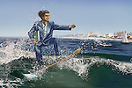 Male executive on surfboard with laptop riding the waves on business trip