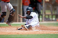 GCL Marlins Omar Lebron (30) slides home during a Gulf Coast League game against the GCL Astros on August 8, 2019 at the Roger Dean Chevrolet Stadium Complex in Jupiter, Florida.  GCL Astros defeated GCL Marlins 4-2.  (Mike Janes/Four Seam Images)