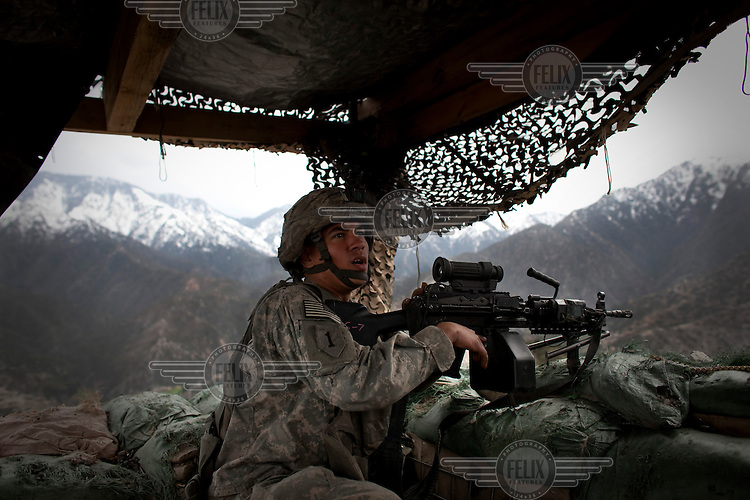 US Army Soldiers from Viper Company 126, 1st Platoon return fire during a fire fight at Restrepo Firebase in the restive Korengal Valley close to the Pakistan border in Kunar. Restrepo, a remote outpost, is known as one of the most violent places in Afghanistan. Located in the Korengal Valley it comes under fire on a daily basis from Anti-Afghan Forces in the local villages and mountains.