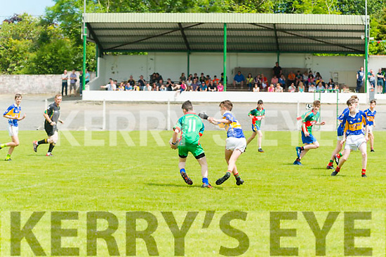 Eoghan Ruadh vs Mid Kerry U14 Football County Championship at the Kilcumin GAA last Sunday. Pictured are Colin O'Leary (Mid Kerry) in action with Shane Evans  (Eoghan Ruadh).