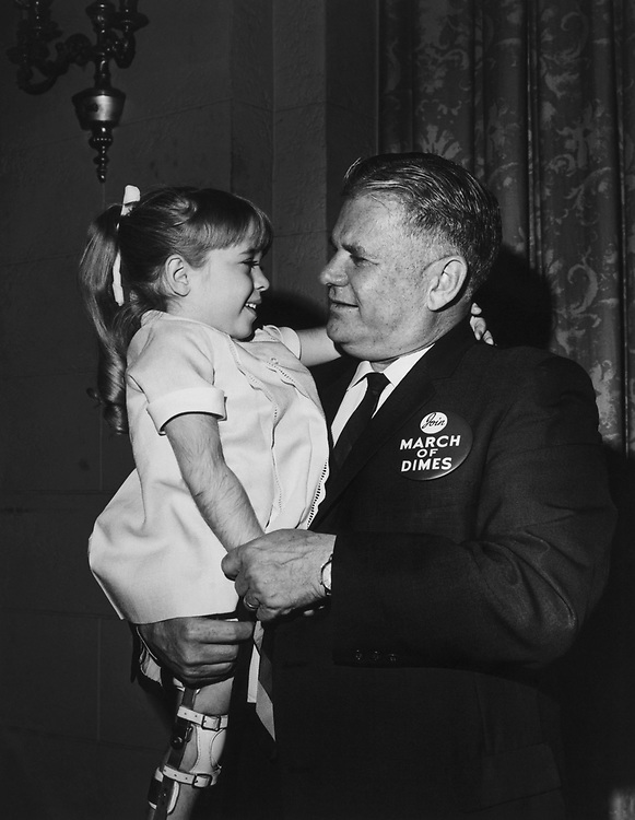Rep. Olin E. Teague, D-Tex., carrying girl. (Photo by CQ Roll Call)