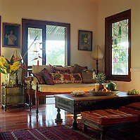 An arrangement of comfortable upholstered Indian furniture in a corner of the living room