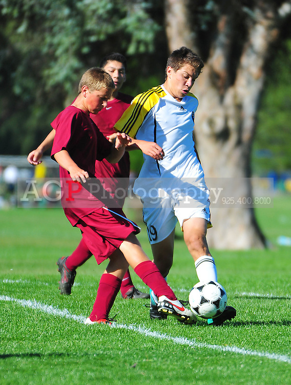 BUSC U16 Advance battle their opponent  in Pleasanton, California.  (Photo by Alan Greth/AGP Photography).
