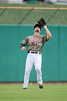 Arkansas Travelers left fielder Dario Pizzano (19) settles under a fly ball during a game against the Frisco RoughRiders on May 28, 2017 at Dickey-Stephens Park in Little Rock, Arkansas.  Arkansas defeated Frisco 17-3.  (Mike Janes/Four Seam Images)