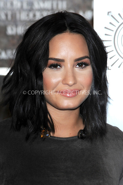 www.acepixs.com<br /> March 20, 2017  New York City<br /> <br /> Demi Lovato attending a lighting ceremony at The Empire State Building to celebrate the 'Small Smurfs Big Goals' campaign and the International Day Of Happiness on March 20, 2017 in New York City.<br /> <br /> Credit: Kristin Callahan/ACE Pictures<br /> <br /> Tel: 646 769 0430<br /> Email: info@acepixs.com