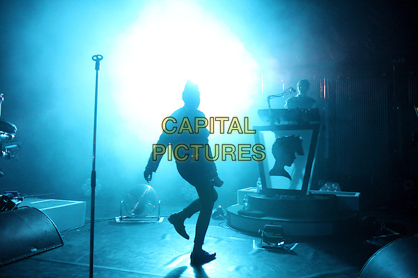 LA ROUX (Eleanor Jackson).Performing live at Shepherd's Bush Empire, London, England..November 26th, 2009.stage concert gig performance music full length black silhouette .CAP/MAR.© Martin Harris/Capital Pictures.