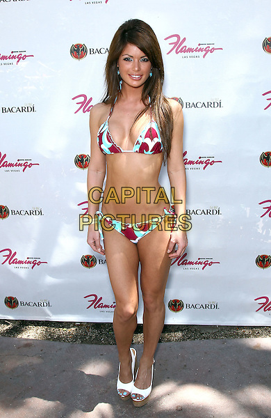 Laura Croft.Laura Croft, in a Kandy Wrappers bikini, hosts at GO Pool at the Flamingo Hotel and Casino, Las Vegas, Nevada, USA..July 17th, 2011.full length white blue red print cleavage belly stomach midriff  peep toe shoes.CAP/ADM/MJT.© MJT/AdMedia/Capital Pictures.