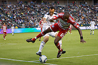Landon Donovan (10) of the LA Galaxy steals the ball away from FC Dallas defender Jackson Goncalves (6). The LA Galaxy defeated FC Dallas 2-1 at Home Depot Center stadium in Carson, California on Sunday October 24, 2010.