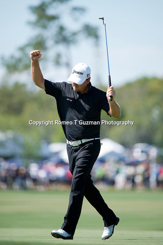 March 25, 2012: Graeme McDowell celebrates his eagle putt on the par 5 6th green during final round golf action of the Arnold Palmer Invitational held at Arnold Palmer's Bay Hill Club & Lodge in Orlando, FL