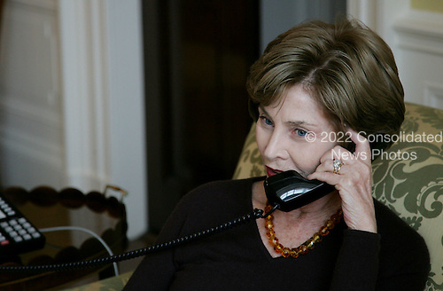 Washington, DC - November 5, 2008 -- First lady Laura Bush speaks on the phone with Michelle Obama Wednesday, November 5, 2008 in the family residence at the White House. Mrs. Bush assured Mrs. Obama that they will enjoy living at the White House, and that it is a wonderful place to raise a family. Also Mrs. Bush extended an invitation to the Obama family to visit the White House. .Credit: Joyce N. Boghosian - White House via CNP