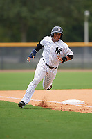 GCL Yankees East first baseman Lisandro Blanco (14) rounds third base during the second game of a doubleheader against the GCL Blue Jays on July 24, 2017 at the Yankees Minor League Complex in Tampa, Florida.  GCL Yankees East defeated the GCL Blue Jays 7-3.  (Mike Janes/Four Seam Images)