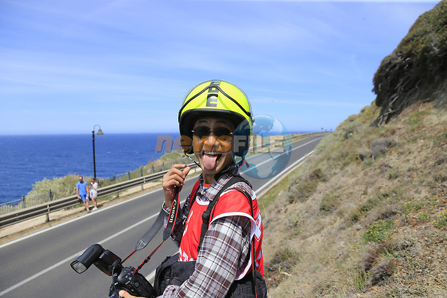 Photographer Yuzuru Sunada at Castelsardo along the Costa Smeralda during Stage 1 of the 100th edition of the Giro d'Italia 2017, running 206km from Alghero to Olbia, Sardinia, Italy. 4th May 2017.<br /> Picture: Eoin Clarke | Cyclefile<br /> <br /> <br /> All photos usage must carry mandatory copyright credit (&copy; Cyclefile | Eoin Clarke)<br /> <br /> All photos usage must carry mandatory copyright credit (&copy; Cyclefile | LaPresse)