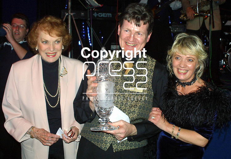 The Irish Coffee World Champion Declan Corbett, Kilworth Co. Cork pictured with his wife Celis (right) and Maureen O'Hara at the Irish Coffee Festival and the celebration of three 60th anniversarys. The theme for the festival was the 1940's. Pic Press 22.