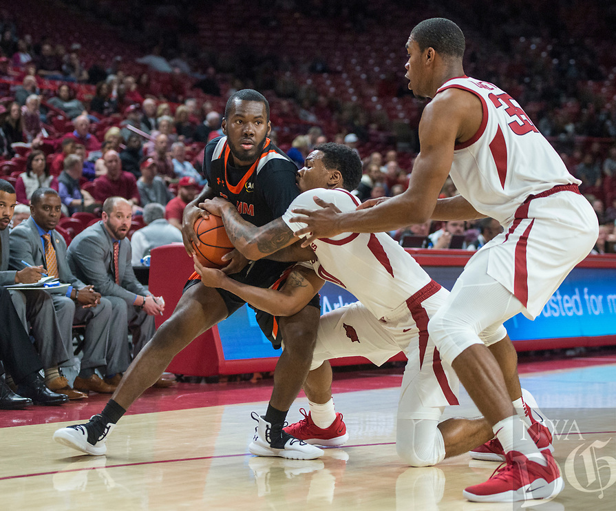 NWA Democrat-Gazette/BEN GOFF @NWABENGOFF <br /> Desi Sills of Arkansas tries to steal from Dillon Nash of Tusculum in the first half Friday, Oct. 26, 2018, during an exhibition game in Bud Walton Arena in Fayetteville.