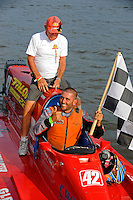 Winner Shaun Torrente and his grandfather Fred Thompson prepare to take a victory lap.