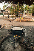 Aldeia Baú, Para State, Brazil. Pot on a fire to extract babassu nut oil in the village.