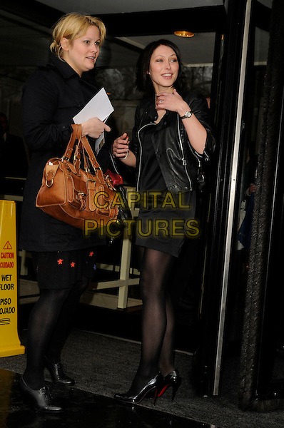 EMMA GRIFFITHS.TRIC Awards 2008, .Grosvenor House Hotel, London, England, March 12th 2008..full length black leather jacket skirt dress .CAP/CAN.?Can Nguyen/Capital Pictures