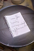 Sign left on the potter's wheel, University College for the Creative Arts, Farnham.