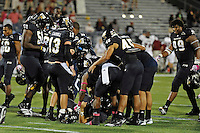 25 October 2011:  FIU's team celebrates Jack Griffin's game-winning field goal in overtime as the FIU Golden Panthers defeated the Troy University Trojans, 23-20 in overtime, at FIU Stadium in Miami, Florida.