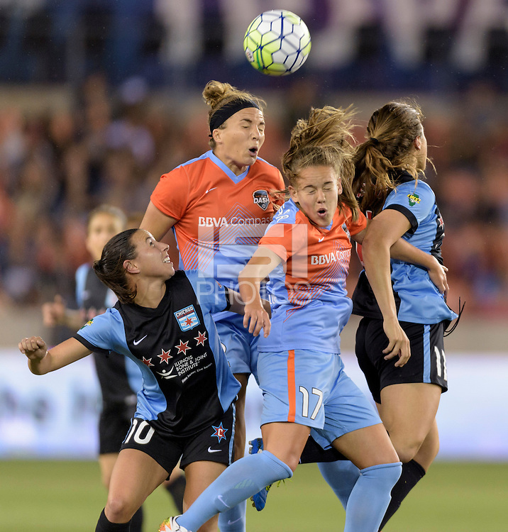Houston Texas - Amber Brooks (12) of the Houston Dash heads the ball away from her goal in the first half against the Chicago Red Stars on Saturday, April 16, 2016 at BBVA Compass Stadium in Houston Texas.  The Houston Dash defeated the Chicago Red Stars 3-1.