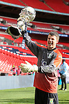 Adam Nicklin of North Ferriby United lifts the FA Trophy aloft after victory over Wrexham after the FA Carlsberg Trophy Final 2015 at Wembley Stadium on March 29, 2015 in London, England. (Photo by David Horn/EAP)