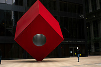 NEW YORK, NY - APRIL 20: A man wearing a face mask due to COVID-19 walks near the red cube sculpture on April 20, 2020. in New York City. United States. U.S. President Trump is looking to get many Americans back to work as soon as possible, but also he recognizes that cities like New York will need to go slow. (Photo by Eduardo MunozAlvarez/VIEWpress)