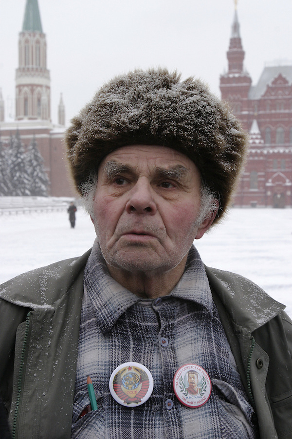 Moscow, Russia, 21/01/2004..Russian Communist Party leader Gennadi Zyuganov and supporters lay wreaths at Lenin's Mausoleum on Red Square on the anniversary of Lenin's death..A Communist supporter listens to Zyuganov giving an impromptu press conference..