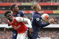 Jarrod Bowen of West Ham United and Bukayo Osaka of Arsenal fc during Arsenal vs West Ham United, Premier League Football at the Emirates Stadium on 7th March 2020