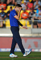 England bowler Chris Noakes reacts to Ross Taylor's shot during the ICC Cricket World Cup one day pool match between the New Zealand Black Caps and England at Wellington Regional Stadium, Wellington, New Zealand on Friday, 20 February 2015. Photo: Dave Lintott / lintottphoto.co.nz