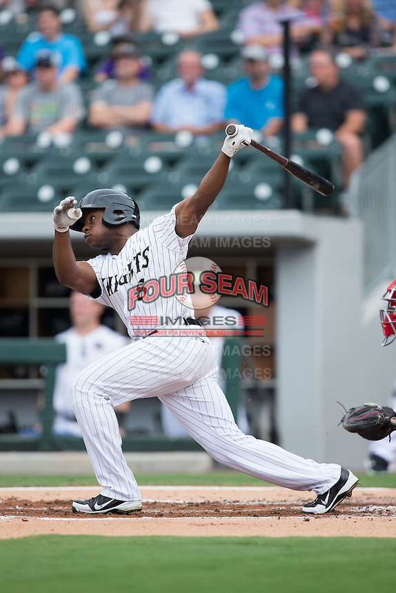 Jason Bourgeois (8) of the Charlotte Knights follows through on his swing against the Pawtucket Red Sox at BB&T BallPark on July 6, 2016 in Charlotte, North Carolina.  The Knights defeated the Red Sox 8-6.  (Brian Westerholt/Four Seam Images)