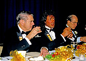 "American actor, director, screenwriter, and producer Sylvester Stallone  center, attends a dinner as he accepts the President's Council on Physical Fitness award at the Washington, DC Touchdown Club dinner in Washington, DC on January 23, 1988.  At left is former Washington Redskins head coach George Allen and at right is Associate Justice of the United States Supreme Court Byron R. ""Whizzer"" White.<br /> Credit: Arnie Sachs / CNP"